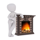 3D figure holds wrench and leans against fireplace Stock Images