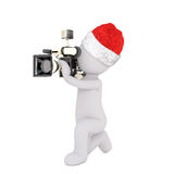 3d film maker filming with a cinematography camera. Kneeling down as he takes the shots, rendered illustration on white wearing a festive Christmas hat Royalty Free Stock Photos