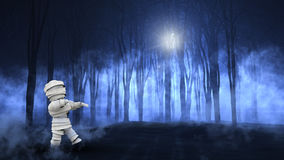 3D foggy spooky forest with walking zombie Royalty Free Stock Photography