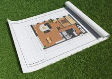 Floor planerar i gräs Arkivfoto