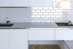 3D framför tätt upp vitt modernt kök i den vita inre Arkivfoto