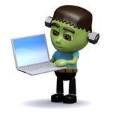 3d Frankenstein hat einen neuen Laptop Stockfotos