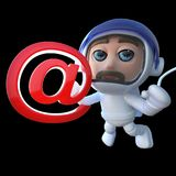 3d Funny cartoon spaceman astronaut holding an email address symbol. 3d render of a funny cartoon spaceman astronaut holding an email address symbol Royalty Free Stock Photo