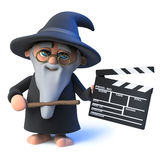 3d Funny cartoon wizard magician character holding a clapperboard Royalty Free Stock Images