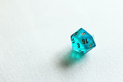 D20 game dice. Blue transparant d20 dice macro photo Royalty Free Stock Images
