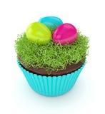3d geef van Pasen-muffin met gras en eieren terug Stock Foto