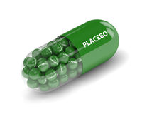 3D geef van placebopil terug met korrels over wit Royalty-vrije Stock Afbeeldingen
