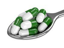 3D geef van placebopillen terug op lepel over wit Stock Fotografie
