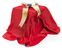 3d gift box under red cloth Royalty Free Stock Photo
