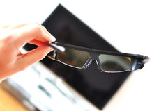 3D glasses. Against TV-set Royalty Free Stock Photo