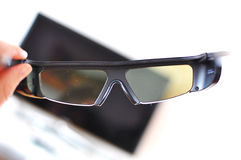 3D glasses. Against TV-set Royalty Free Stock Photography