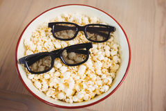 3D glasses in bowl of popcorn Royalty Free Stock Image