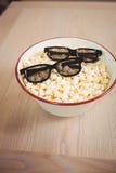 3D glasses in bowl of popcorn Stock Photo