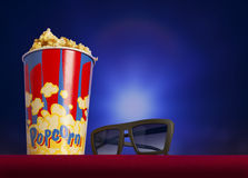 3d glasses and popcorn on armchair cinema Royalty Free Stock Photography