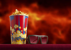 3d glasses and popcorn on armchair cinema. 3d glasses and popcorn on red armchair cinema. Blockbuster concept Stock Photography