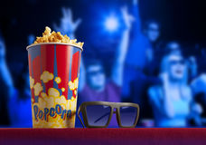 3d glasses and popcorn on armchair cinema. 3d glasses and popcorn on red armchair cinema. Blockbuster concept Stock Photos