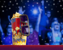 3d glasses and popcorn on armchair cinema. 3d glasses and popcorn on red armchair cinema. Blockbuster concept Royalty Free Stock Photography