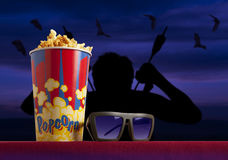 3d glasses and popcorn on armchair cinema. 3d glasses and popcorn on red armchair cinema. Blockbuster concept Royalty Free Stock Photo