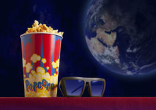 3d glasses and popcorn on armchair cinema. 3d glasses and popcorn on red armchair cinema. Blockbuster concept Stock Image