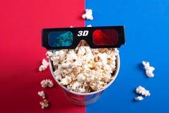 3d glasses on popcorn box Stock Photos