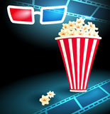3d glasses with popcorn and film strip. 3d glasses in dark movie theater with popcorn and film strip Stock Photography