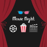 3D glasses Popcorn Movie reel Open clapper board Luxury red silk stage theatre curtain.  Royalty Free Stock Photo