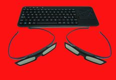 3d glasses on red background. Red table stock photography