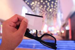 3d glasses with tickets in young hand man. With cinema background Stock Image