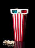 3D glasses on top of the popcorn bucket Stock Images