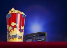3d glazen en popcorn op leunstoelbioskoop Royalty-vrije Stock Fotografie