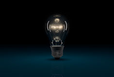 3D glowing light bulb on dark blue background Royalty Free Stock Image