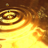3d Gold droplet and ripples Stock Images