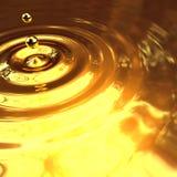 3d Gold droplet and ripples. 3d render of liquid gold droplet and ripples Stock Images