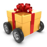 3d Gold gift on wheels Stock Images