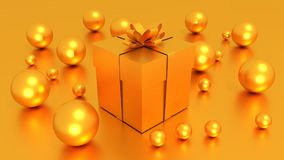 3d GOLDEN gift box  tied with a GOLDEN satin ribbon bow. And golden balls on golden background.for Christmas and HAPPY new year.2018 Royalty Free Stock Photography