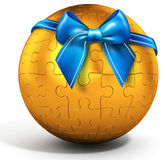 3d golden  spherical puzzle with bow Royalty Free Stock Photography