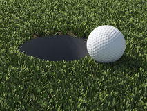 3d Golf ball at edge of hole Royalty Free Stock Photo