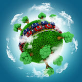 3D grassy globe with cars on roads against a blue cloudy sky Royalty Free Stock Photo