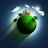 3D grassy globe with house and trees on a blue sky background Royalty Free Stock Photo