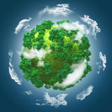 3D grassy globe with trees against a blue cloudy sky Royalty Free Stock Image