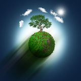 3D grassy globe with trees on a blue sky background Stock Photography