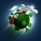 3D grassy globe with trucks on a blue sky background Stock Image