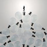 3d growing light bulb standing out Stock Photos
