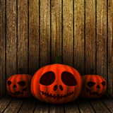 3D grunge Halloween jack o lanternS on a wooden background Stock Image