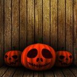 3D grunge Halloween jack o lanternS on a wooden background Stock Image