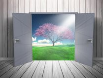 3D grunge room interior with open door looking out to countrysid. 3D render of a grunge room interior with open door looking out to a countryside andscape Royalty Free Stock Image