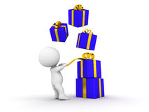 3D Guy with gifts falling over him. A 3d guy pulling on a gift ribbon, and wrapped gift boxes falling over him Royalty Free Stock Images