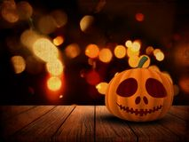 3D Halloween background with pumpkin on wooden table against a g Stock Photo