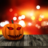 3D Halloween background with pumpkin on a wooden table Stock Photo