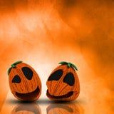 3D Halloween-pompoenen op een grunge watercolour achtergrond Stock Afbeelding